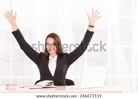Business woman working on laptop computer at office. Modern business woman in the office with copy space. Portrait of businesswoman with laptop writes on a document at office. Office worker of laptop - stock photo