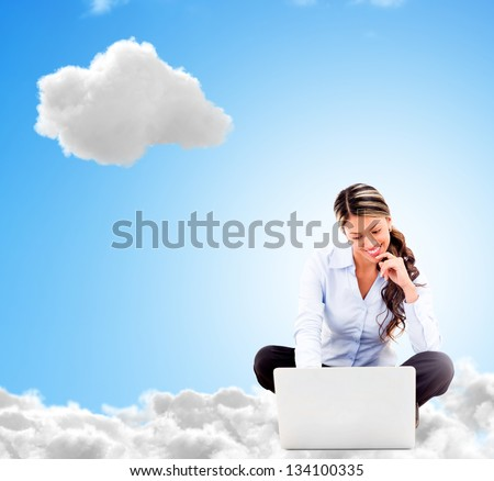 Business woman working online from a cloud and looking happy - stock photo