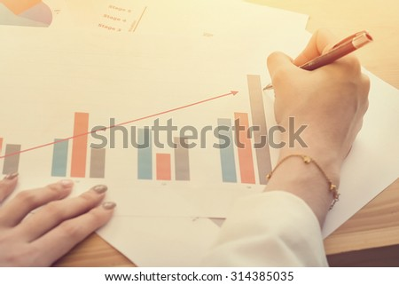 business woman working with document vintage tone. - stock photo