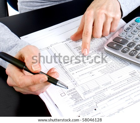 Business woman working with documents in office - stock photo