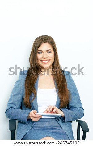 Business Woman Working with tablet, pad. Sitting in chair. isolated on white background portrait of smiling business woman.