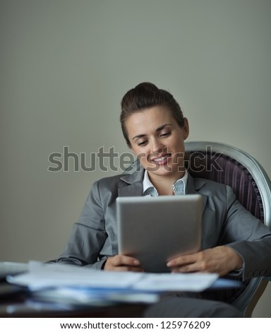 Business woman working with tablet PC in hotel room