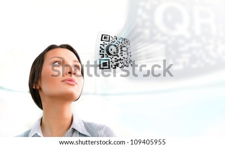 Business woman working with virtual qr code - stock photo