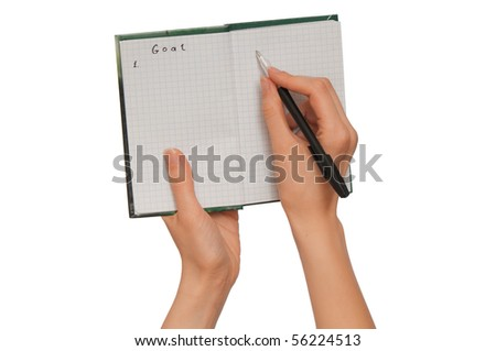 business woman writes goals for business plan - stock photo