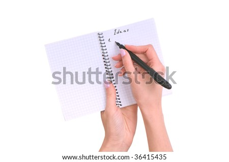 business woman writes ideas for business plan