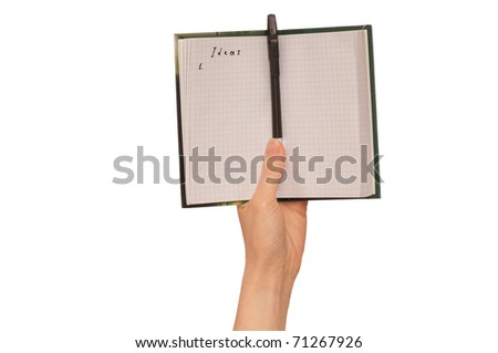 business woman writes ideas for business plan - stock photo