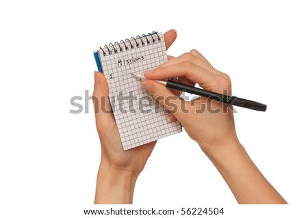 business woman writes missions for business plan - stock photo