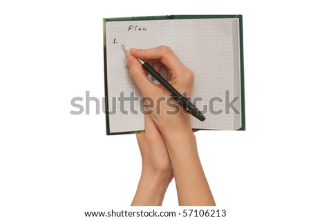 business woman writes notes for business plan - stock photo