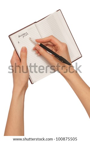 business woman writes notes for business plan in the notebook - stock photo