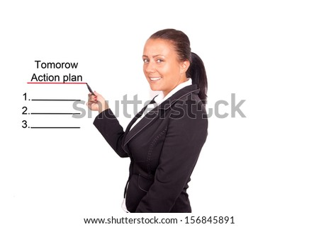 business woman writing action plan - stock photo