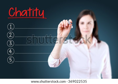 Business woman writing blank Charity list. Blue background.  - stock photo