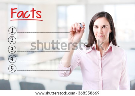 Business woman writing blank Facts list. Office background.  - stock photo