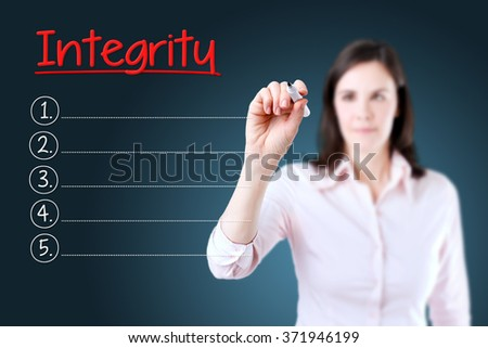 Business woman writing blank Integrity list. Blue background.  - stock photo