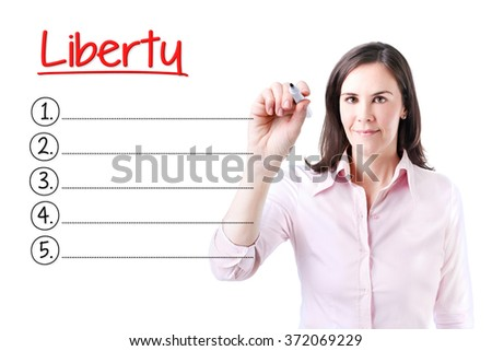 Business woman writing blank Liberty list. Isolated on white.  - stock photo