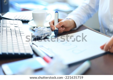 Business woman writing blank plan list - stock photo