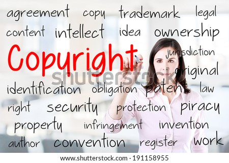Business woman writing copyright concept. Office background.  - stock photo