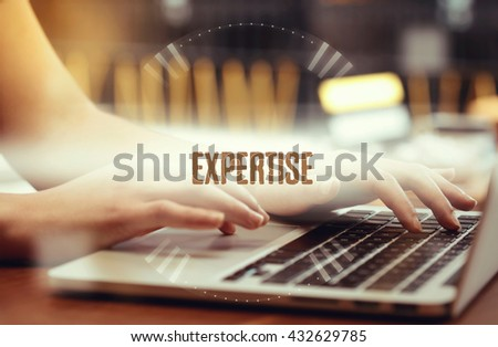 Business woman writing Expertise on the computer - stock photo