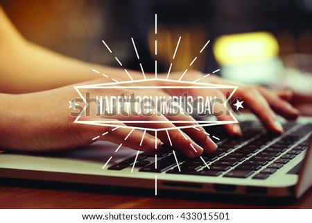 Business woman writing Happy Columbus Day on the computer - stock photo