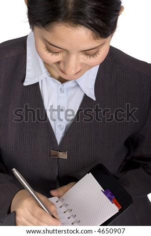 Business woman writing in a personal organizer