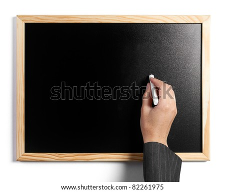 Business woman writing in empty black board with a white chalk