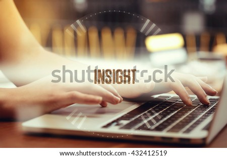 Business woman writing Insight on the computer - stock photo