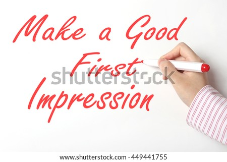 Business woman writing make a good first impression c word on whiteboard - stock photo