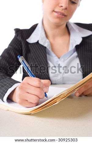 Business Woman Writing notes at desk isolated on white - stock photo