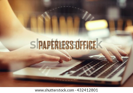 Business woman writing Paperless Office  on the computer