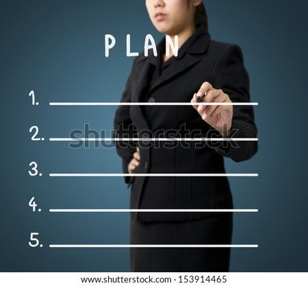 Business Woman Writing Plan List - stock photo
