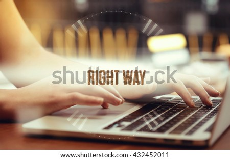 Business woman writing Right Way on the computer - stock photo