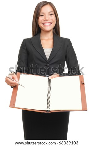Business woman writing / signing in paper document . Asian professional isolated on white background. - stock photo