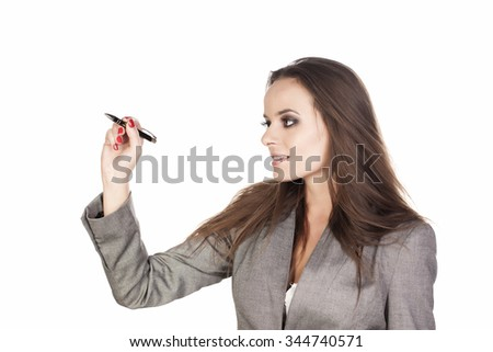 Business woman writing something with a marker on white background.