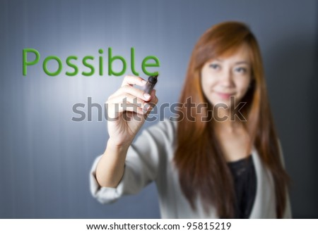 "Business woman writing the word  ""Possible"""