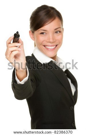Business woman writing with black marker pen on virtual screen. Young professional smiling wearing suit. Chinese Asian / Caucasian businesswoman isolated on white background. - stock photo
