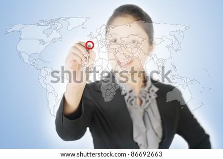 Business woman writing world map screen - stock photo