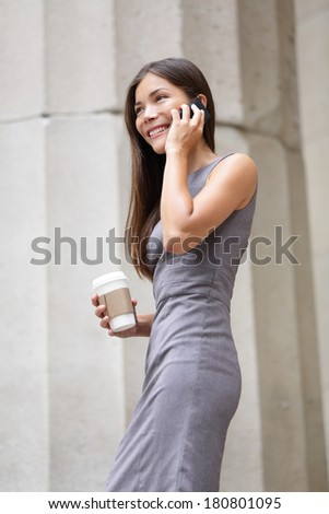 Business woman - young lawyer professional talking on smart phone. Mixed race Asian / Caucasian businesswoman smiling happy. - stock photo