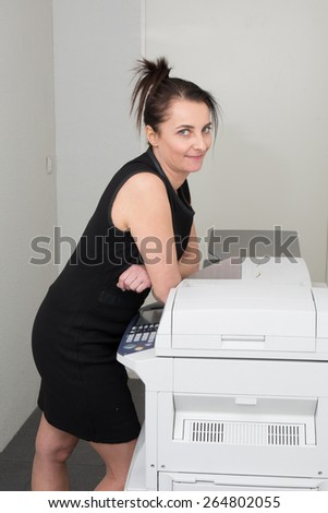 Business  Women   at the office at her desk - stock photo