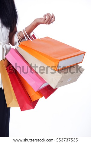 business women carrying colorful shopping bag isolated on white background.