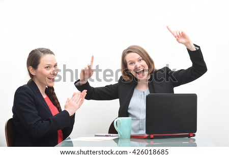 Business women celebrating success at meeting by clapping - stock photo