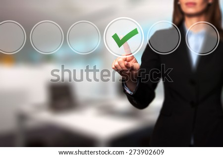 Business women  check mark on virtual screen. Finger on a checklist box and ticking. Business technology concept. Isolated on office. Stock Image - stock photo