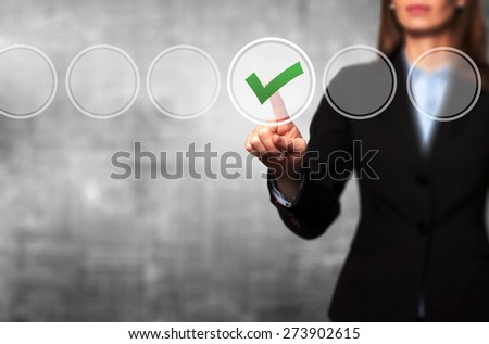 Business women  check mark on virtual screen. Finger on a checklist box and ticking. Business technology concept. Isolated on grey. Stock Image - stock photo