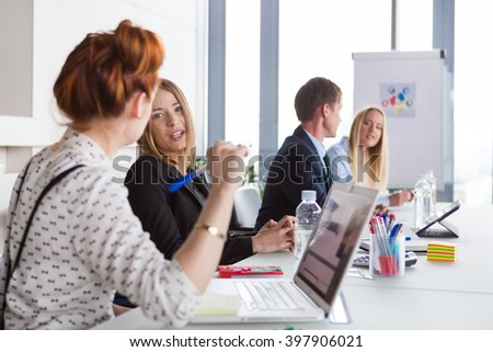 Business women discussing project during the meeting in modern office. - stock photo