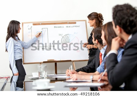 business women doing a presentation in an office - stock photo
