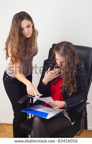 Business women doing paper work - stock photo