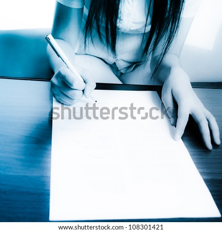 business women endorse on paper contract - stock photo