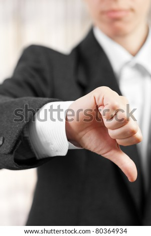 Business women hand gesture thumb down failure sign - stock photo