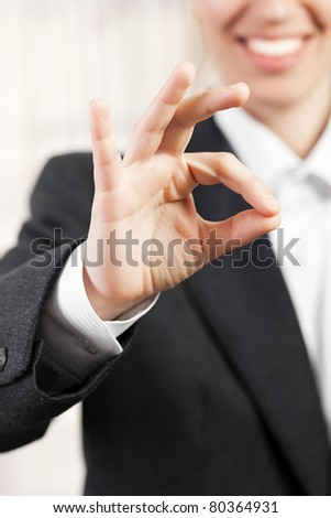 Business women hand gesturing OK or success sign
