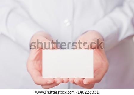 Business women handing a blank business card - stock photo