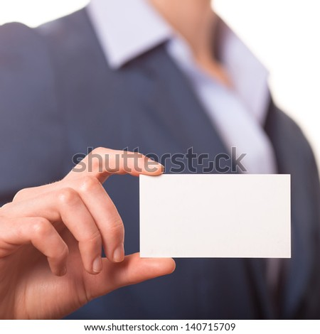 Business women handing a blank business card - stock photo