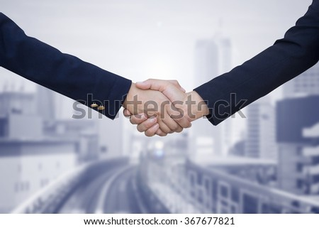 business women handshake isolated on blurred city urban metropolis landscape background,agreement of financial and business hands concept.improvement/development of world class business conception. - stock photo